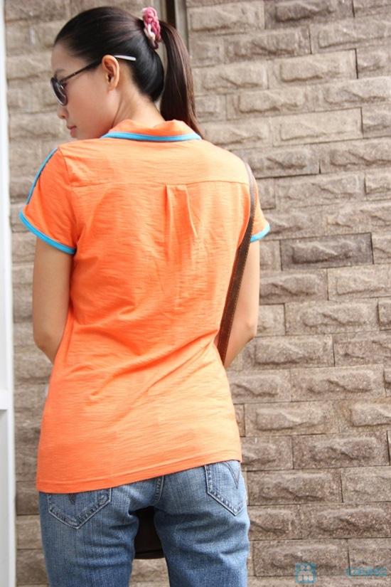 Bạn gái nổi bật với Áo thun cam viền xanh - 4